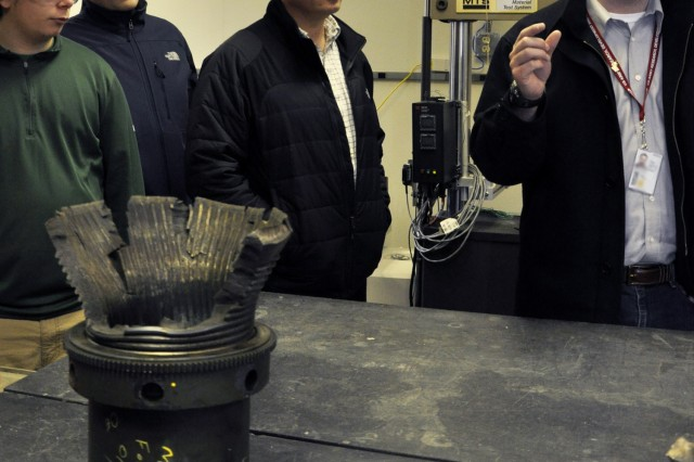 "Benét Lab's Eric Gillette, who is a materials engineer and who coordinated the visit by Shaker High School, explaining the fatigue process where engineers test equipment to failure. "" at U.S. Army Watervliet Arsenal."