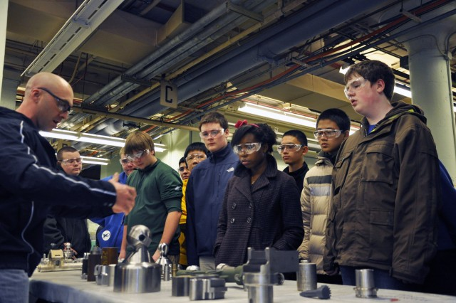"Benét Lab's Andrew Brassard explaining the machining required to fabricate minor components for weapon systems. "" at U.S. Army Watervliet Arsenal."