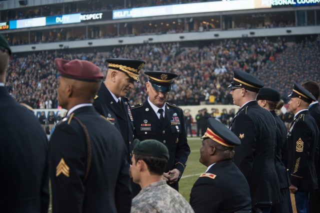 Army Chief of Staff Gen. Raymond T. Odierno and Sgt. Maj. of the Army Raymond F. Chandler III talk to honorees at a ceremony in recognition of valor in Operations Iraqi and Enduring Freedom during the 113th Army vs. Navy football game, Dec. 8, 2012, in Philadelphia.