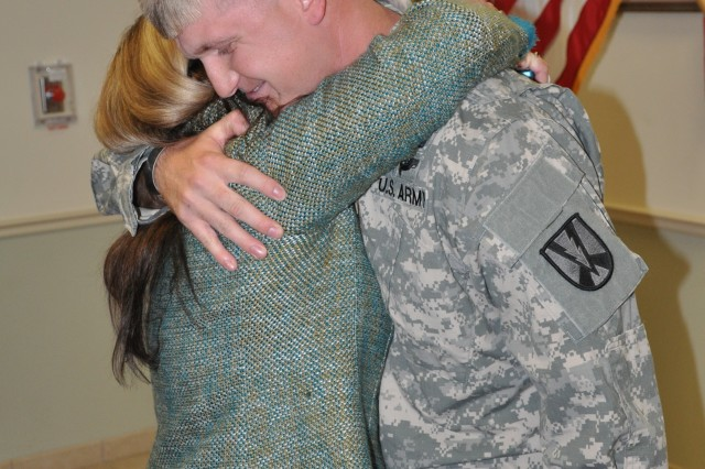 Sgt. 1st Class Clint Lyons receives a hug from his mother, Sharmin Hodge, during the ceremony.