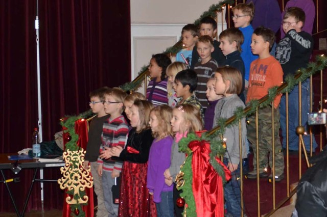 Children from the German elementary school in Baumholder perform in the Rheinlander Community Club after the tree lighting ceremony.