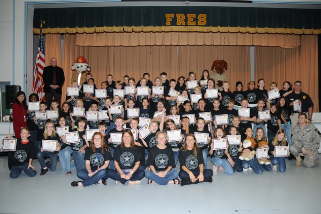 Fort Rucker Elementary School fifth graders cheer after receiving their DARE graduation certificates during a ceremony at the FRES gymnasium Dec. 7.