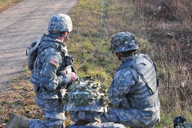 Soldiers in A Company, 3rd Brigade Special Troops Battalion watch the explosion that results from firing a Man Portable Line Charge during a training exercise Dec. 4 at Range 44.