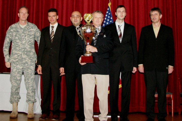 (From left) Following the presentation, Col. Christopher Roscoe, 405th AFSB commander, stands with winners of the Connelly award for excellence in the food service category of dining facilities operated primarily by civilian food service personnel. Next to Roscoe are Guenther Melzig, dining facility manager, Karl Rohrer, shift Leader, Adriano Colella, acting shift leader, Klaus Kueffner, administration clerk, and Fran Lohner, food service technician, all from the Grafenwoehr dining facility in Germany. (Photo by Steven Stanfill, 402nd AFSB Public Affairs)