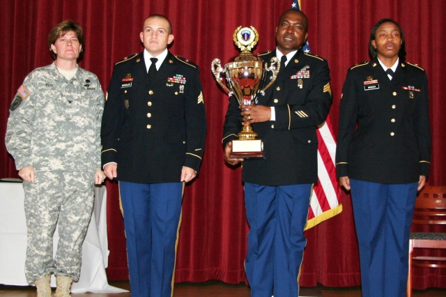 (From left) Following the presentation, Col. Cynthia Fox, U.S. Army Europe, Logistics, stands with Connelly award recipients in the Field Category. Next to Fox are Spc. Gary Gonzalez, Sgt. Kerwin Solomon and Spc. Likisha Green, 16th Sustainment Brigade, 21st Theater Sustainment Command.  (Photo by Steven Stanfill, 402nd AFSB Public Affairs)