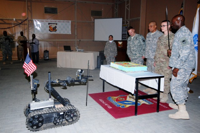 Col. John Kuenzli, commander, 402nd Army Field Support Brigade, along with the oldest Soldier, Master Sgt. Donald John Guillory, Kuwait Battalion, and the youngest Soldier, Sgt. Benjamin Wagner, Joint Robotics Repair Detachment-Kuwait, join Command Sgt. Maj. Nathaniel Bartee Sr., in cutting the 402nd birthday cake Oct. 16 at Camp Arifjan. (Photo by Johnnie Frazier, 402nd AFSB Public Affairs)