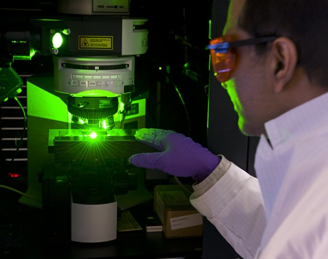An Army scientist uses Raman Chemical Imaging technology to identify explosives left on fingerprints