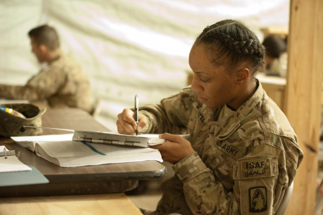 Spc. Jalisa Mitchell, B Company, 4th Battalion, 12th Combat Aviation Brigade, Task Force Ready avionics equipment repair, a native of Dallas, Texas takes notes during a class session covering probability and statistics in a classroom in the TF Ready footprint in Balkh province, Afghanistan Nov. 14. (U.S. Army Photo by Sgt. Duncan Brennan)