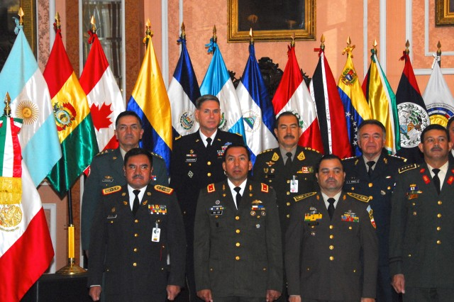 Some of the Army chiefs attending the Conference of American Armies pose for an official photograph.  The CAA held an Extraordinary Commanders' Meeting Dec. 10-13 in Mexico City. The CAA, comprised of 20 member armies, five observer armies and two international military organizations from the Caribbean, Central, North and South American nations, is the largest gathering of army chiefs in the region.  CAA is a forum for chiefs of armies to come together and discuss issues of mutual interest in order to contribute to hemispheric security, protection against threats and to enhance interpersonal relationships. The U.S. Army South commanding general, Maj. Gen. Frederick S. Rudesheim led the U.S. delegation at the Extraordinary Commanders' Meeting on behalf of the Chief of Staff of the Army.