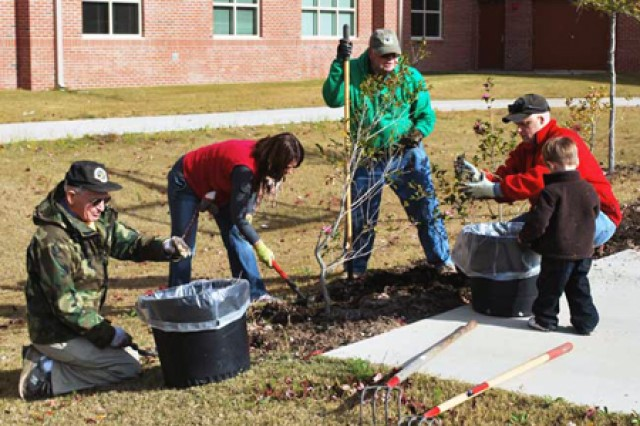 Garden volunteers, from left, Bob Fox, Beth Nelson, Mike Newman, Lt. Col. Jay Nelson and Judd Nelson tend the plants at the Warrior Transition Battalion garden. (Photo by Jonelle Kimbrough)