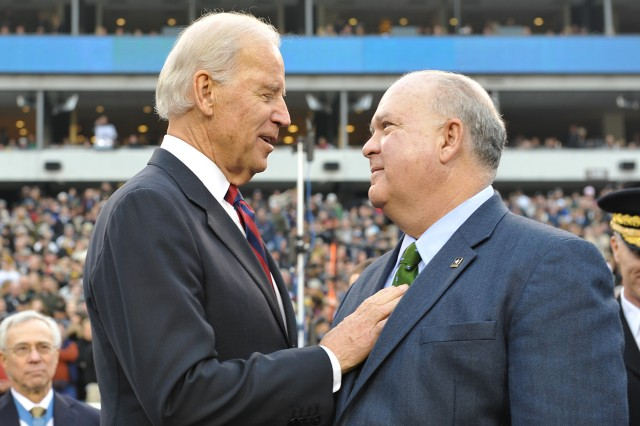 Vice President of the United States Joe Biden greets Under Secretary of the Army Joseph W. Westphal during the 113th Army vs. Navy football game in Philadelphia, Pa., 8 Dec. 2012.