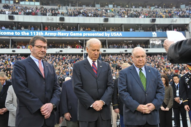 Vice President of the United States Joe Biden praying with U.S. Deputy Secretary of Defense Ashton Carter (left) and Under Secretary of the Army Joseph W. Westphal (right), just before the 113th Army vs. Navy football game  in Philadelphia, Pa., 8 Dec. 2012.
