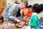 402nd FA Soldiers share Meals Ready to Eat with Partners in Education students