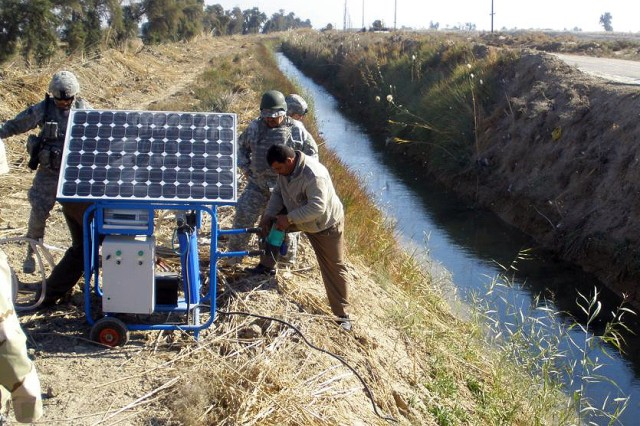 Water and alternative energies will become increasingly important in the year 2030 and beyond. Here, Soldiers from the 1st Armored Division, and local residents, install a solar-powered water filter in Chaka 1, Lutifiyah Nahia, Iraq.