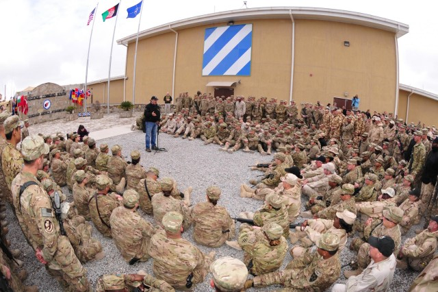 Secretary of Defense Leon Panetta speaks with deployed service members and coalition forces at Regional Command (South) headquarters on Kandahar Airfield, Afghanistan, Dec. 13, 2012. Panetta visited the region to meet with commanders and talk with their service members.