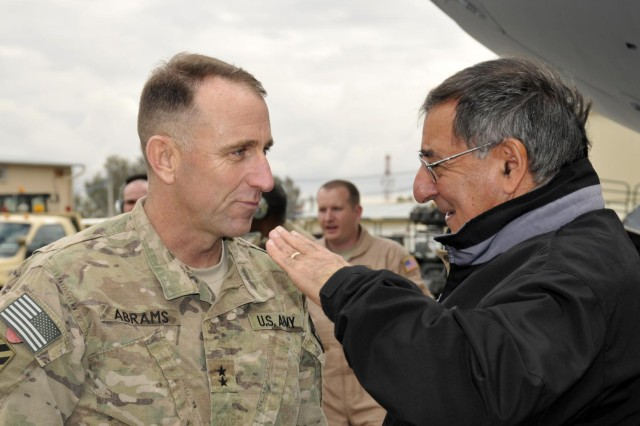 """Secretary of Defense Leon Panetta speaks to Maj. Gen. Robert """"Abe"""" Abrams, Third Infantry Division and Regional Command (South) commanding general, upon arrival at Kandahar Airfield, Afghanistan, Dec. 13, 2012. Panetta visited the region to meet with commanders and talk with their troops."""