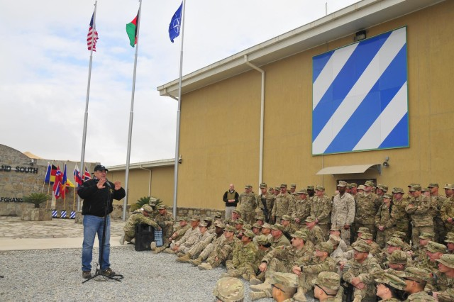 Secretary of Defense Leon Panetta speaks with deployed service members and coalition force members at Regional Command (South) headquarters on Kandahar Airfield, Afghanistan, Dec. 13, 2012. Panetta visited the region to meet with commanders and talk with their troops.