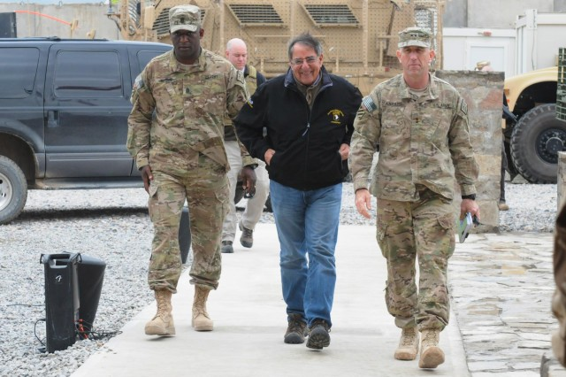 """Secretary of Defense Leon Panetta walks with Maj. Gen. Robert """"Abe"""" Abrams (right), Third Infantry Division and Regional Command (South) commanding general, and Command. Sgt. Maj. Edd Watson, Third Infantry Division and Regional Command (South) command sergeant major, at region's headquarters on Kandahar Airfield, Afghanistan, Dec. 13, 2012. Panetta visited the region to meet with commanders and talk to their troops."""