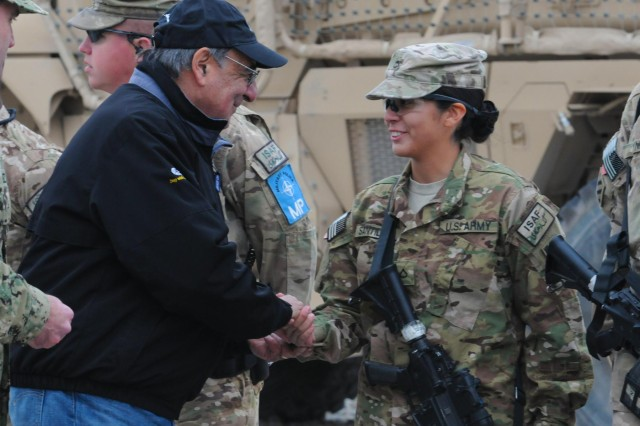 Secretary of Defense Leon Panetta shakes hands with Pfc. Christina Santillan of the Third Infantry Division at Regional Command (South) headquarters on Kandahar Airfield, Afghanistan, Dec. 13, 2012. Panetta visited the region to meet with commanders and talk with their troops.
