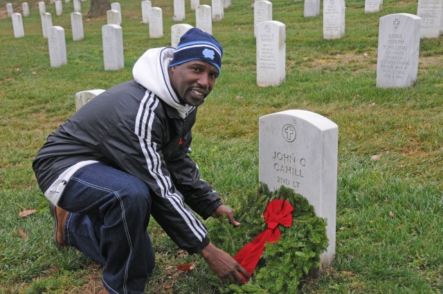 Wayne Miller, from Waldorf, Md., said Dec. 15, 2012, was his first time at Arlington National Cemetery, Va. He was with his wife, Pamela, laying wreaths at gravesites. Both are retired Soldiers, Pamela retiring in 2009 and Wayne in 2010. Wayne served three tours in Iraq and rose to the rank of sergeant major.