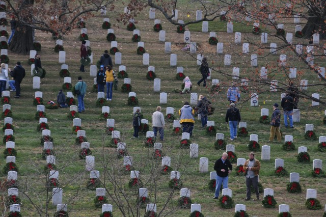 Tens of thousands pay their respects to veterans by laying wreaths at gravesites at Arlington National Cemetery, Va., Dec. 15, 2012.
