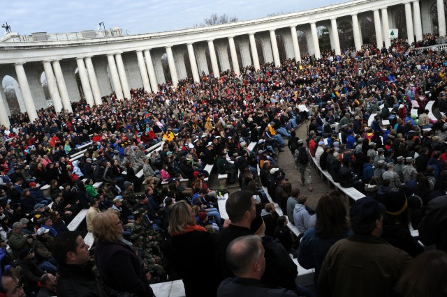 Before moving out into Arlington National Cemetery, Va., Dec. 15, 2012, to lay wreaths at gravestones, thousands of volunteers rallied at the Memorial Amphitheater.