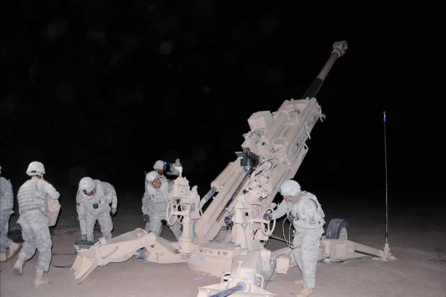 Soldiers from 4th Battalion, 27th Field Artillery Regiment, 2nd Brigade Combat Team, 1st Armored Division, prepare to fire the M777 Howitzer, during Network Integration Evaluation 13.1 conducted at Fort Bliss, Texas and White Sands Missile Range, N.M.