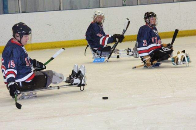 Wounded warriors from Walter Reed National Military Medical Center attend a recent sled hockey workout at the Rockville Ice Arena where the USA Warriors ice hockey team practices.