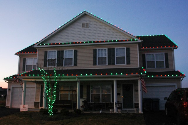 "The Lopus home in Bayside Village glows bright at night thanks to more than 1,000 LED Christmas lights. Bob Schmidt, owner of Christmas Decor by Bob's Lawn Care, installed the lights free of charge to say ""thank you,"" to a military Family."