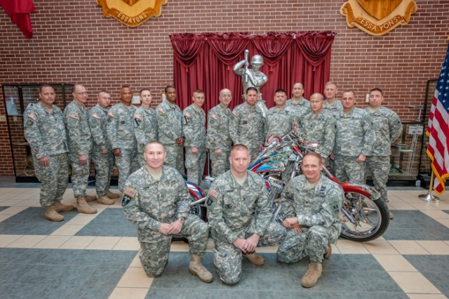 Soldiers celebrate the Army National Guard's 376th birthday Dec. 13 at the National Guard Patriot Chopper display in Lincoln Hall Atrium. Members of Fort Leonard Wood had the rare opportunity to see the Patriot Chopper up close throughout the week in combination with the event.