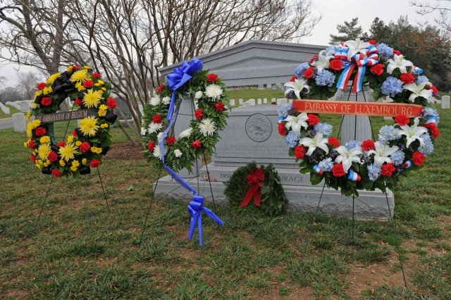 Wreaths from the embassies of Belgium and Luxembourg and the Veterans of the Battle of the Bulge rest at the Arlington National Cemetery (Va.) memorial honoring the 19,000 American service members who died in the battle between Dec. 16, 1944, and Jan. 25, 1945.