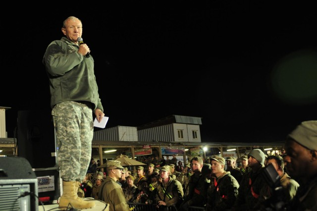 Gen. Martin E. Dempsey, chairman of the Joint Chiefs of Staff, expresses his appreciation to multinational service members, Dec. 16, 2012, gathered for the annual USO holiday show at Kandahar Airfield, Afghanistan.