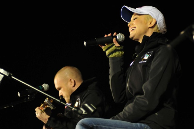 Country music artist Kellie Pickler, with her husband and guitarist Kyle Jacobs, perform for hundreds of multinational service members, Dec. 16, 2012, at Kandahar Airfield, Afghanistan. This is Pickler's sixth USO tour since 2007.