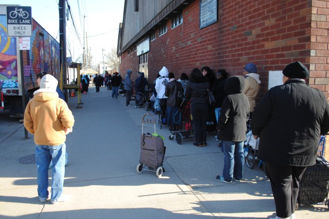 Community residents wait in line in front of the Coney Island (N.Y.) Gospel Assembly, Dec. 13, 2012. Following Hurricane Sandy, the church has served as the central distribution center in Coney Island for the needy.
