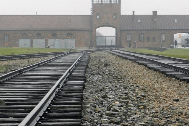 Visitors to Birkenau enter along the infamous railroad tracks.