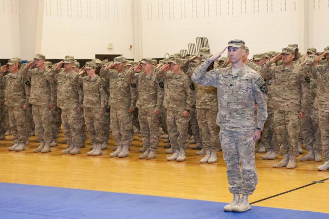JOINT BASE LEWIS-McCHORD, Wash.--Lt. Col. Ross Coffey, 2nd Brigade, 2nd Infantry Division stands before the formation of more than 200 Soldiers returning from Afghanistan during a welcome home ceremony at Wilson Sports and Fitness Center, Joint Base Lewis-McChord-North, Dec. 16. This is the first group of 2nd Bde, 2nd Inf. Div. Soldiers to redeploy and have the good fortune to make it back home from Afghanistan before the holidays.