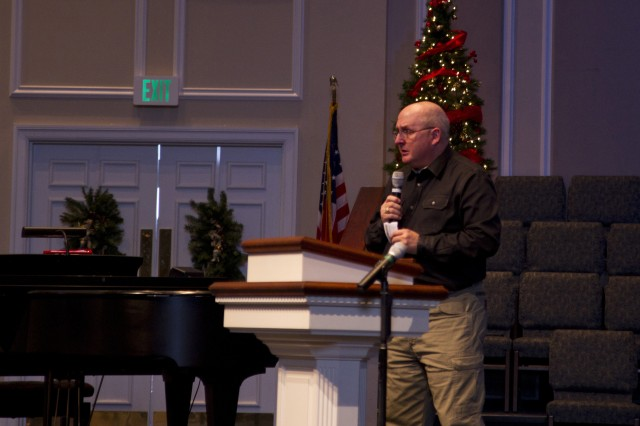 Retired Command Sgt. Maj. Barry Blount speaks during a small ceremony in memory of his son, 2nd Lt. Matthew Blount at the First Baptist Church in Pelham, Ala. The ceremony, held on December 15, marked the installation of a stained glass window in Blount's memory during the ceremony. Blount was commissioned on March 7 and passed away on March 10 due to leukemia and cancer. According to all who knew him, the window's Praying Soldier design embodied the spirit of the young officer from his youth through his Army career as a combat medic as well as a member of his family, his church and community.