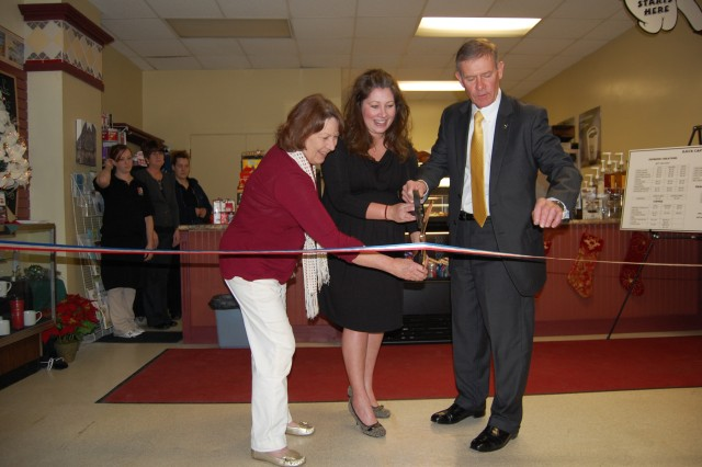 ROCK ISLAND ARSENAL, ILL. -- Joel Himsl, Rock Island Arsenal garrison manager (right), Sherri Saskowski, local operations manager for Sheridan's Hospitality Management (middle), and Gail Starkweather, Káva Café's owner (left), cut the ceremonial ribbon at the grand opening of the café on Dec. 13.