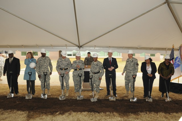 The U.S. Army Materiel Command and the U.S. Army Security Assistance Command hosted a cafeteria groundbreaking ceremony here, December 17 to feed its roughly 1700 employees. From left to right: Stephan Jones, USASAC employee; Robin Warren, AMC employee; Sgt. Maj. Michael Brown, AMC employee; Maj. Gen. Frank D. Turner, USASAC's commander; Lt. Gen. Patricia E. McQuistion, AMC's deputy commanding general; Gen. Dennis L. Via, AMC's commander; John B. Nerger, AMC's executive deputy to the commanding general; Col. John Hamilton, Redstone Arsenal garrison commander; Marticia Banks-Booker, AMC employee and union representative; and Ingrid Qualls, AMC employee.