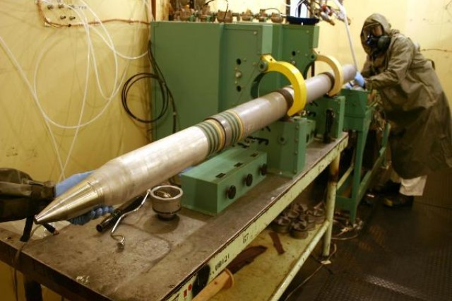 A chemical operations crew from the Umatilla Chemical Depot separate rocket motor and warhead sections on nine M55 rockets that were sent to an Army lab in Picatinny, N.J., on June 13 for propellant sampling and analysis. Results from the analysis are expected in four to six weeks.