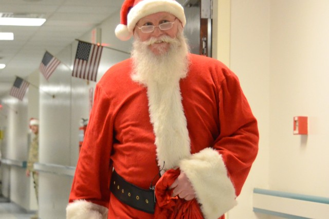 """BAGRAM AIRFIELD, Afghanistan """" Santa Claus makes an appearance at the Craig Joint Theater Hospital at Bagram Airfield, Afghanistan, to give Christmas stockings to wounded warriors and staff members, Dec. 18, 2012. (U.S. Army photo by Staff Sgt. David Overson, 115th Mobile Public Affairs Detachment)"""