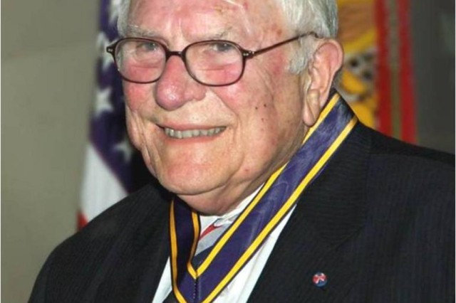 """The U.S. Army Test and Evaluation Command headquarters building was dedicated to Walter W. Hollis, a former Deputy Under Secretary of the Army for Operations Research, in a ceremony at the ATEC headquarters Dec. 13. Walter, whose distinguished career spanned more than five decades, is known as the """"Grandfather of Test and Evaluation."""""""