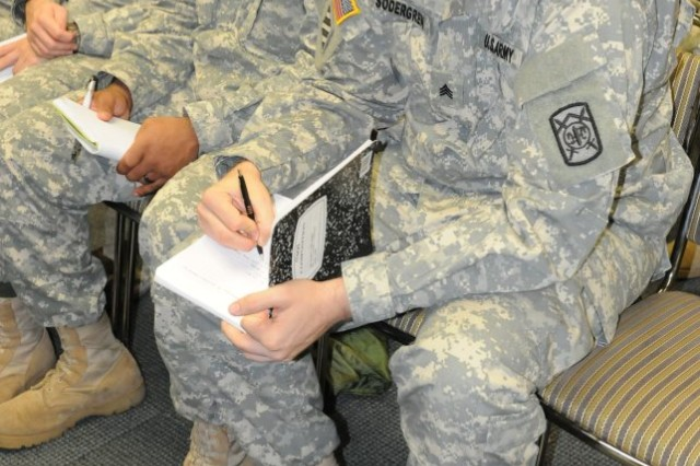 """CAMP HUMPHREYS """" Sergeant Joshua Sodergen, a native of Rockford, Ill, assigned to the 94th Military Police Battalion, 501st Sustainment Brigade takes notes during the 94th MP Noncommissioned Officer Professional Development in the Super Gym on Camp Humphreys, December 12. The NCOPD preceded the 94th MP NCO induction Ceremony held at the Humphrey's theatre later that afternoon. (U.S. Army photo by Staff Sgt. Robert DeDeaux 501st  SBDE Public Affairs)"""