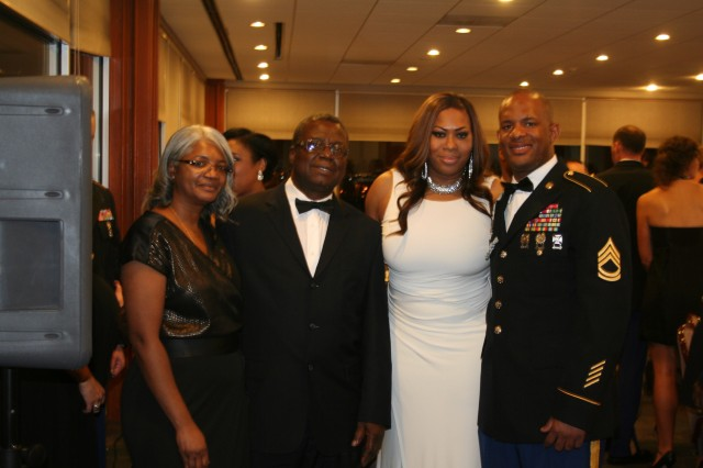 "Sgt. 1st Class Anthoney Vernon, right, senior Human Resources noncommissioned officer, with 2nd Battalion, 381st Regiment, 479th Field Artillery Brigade, Division West, enjoys the unit's Military Ball in Dallas Dec. 1 with his parents and his guest, Shon Bradford, second from right. ""It was very professional and friendly,"" Bradford said. ""I felt like I knew everyone there, and I had a ball."" (Photo by 1st Sgt. Mary Jackson, 2nd Battalion, 381st Regiment, 479th Field Artillery Brigade, Division West)"