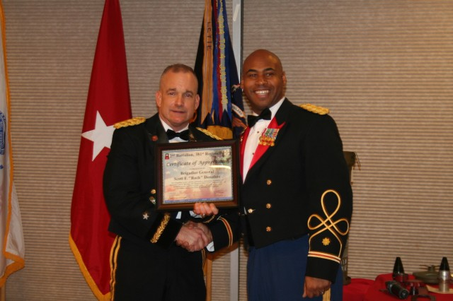 Maj. Julian Dodd, right, executive officer of 2nd Battalion, 381st Regiment, 479th Field Artillery Brigade, Division West, poses for a picture with Brig. Gen. Scott Donahue, Army Reserve Command deputy chief of staff, G-3/5/7, at the regiment's Military Ball Dec. 1 in Dallas. Donahue was guest speaker at the event. (Photo by 1st Sgt. Mary Jackson, 2nd Battalion, 381st Regiment, 479th Field Artillery Brigade, Division West)