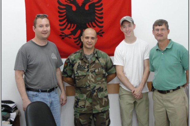 Left to right: John Schwarz, Captain Vide of the Albanian Armed Forces, Brandon Bruey and Ray Diberardo pose for a picture at the end of a succesful demilitarization mission in Albania last July.