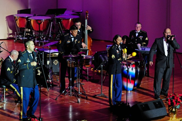 "The 77th Army Band's Latin band ensemble plays the classic ""Santa Claus is Coming to Town"" Dec. 15 at the holiday concert in McMahon Memorial Auditorium."