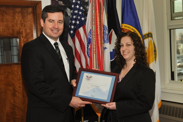 Dale A. Ormond, director of the U.S. Army Research, Development and Engineering Command, presents Lauren McNew with a Presidential Volunteer Service Award.