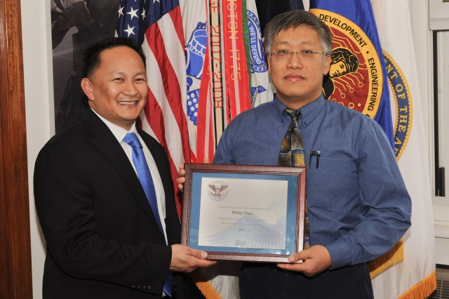 Louie Lopez, U.S. Army Research, Development and Engineering Command STEM outreach program manager, presents Philip Chan with a Presidential Volunteer Service Award.