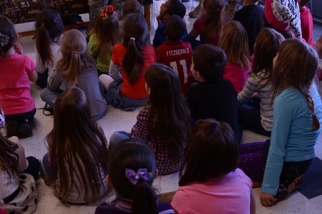 Chief Warrant Officer Jerry Wood, a volunteer with the 7th Squadron, 17th Cavalry Regiment, reads to the students at Rossview Elementary School during story-time Dec. 19. The squadron is a partners with the school through the adopt-a-school program, which the Soldiers hoped to help encourage reading among children. (U.S. Army photo by Sgt. Shanika L. Futrell, 159th Combat Aviation Brigade Public Affairs/RELEASED)